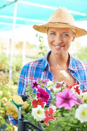 Portrait of woman cultivating flowers Stock Photo