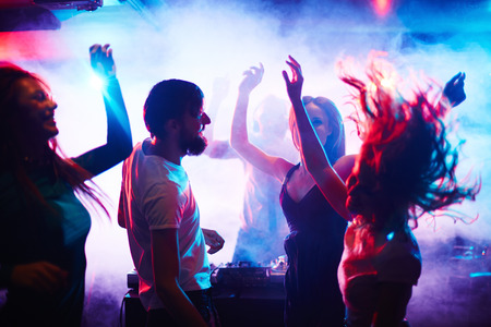 friends party: Young people dancing in nightclub