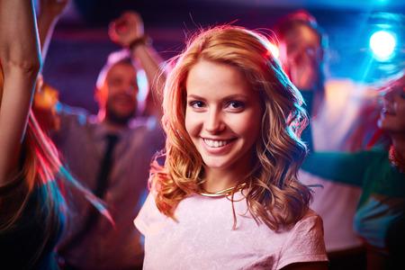nightclub crowd: Portrait of young woman in nightclub