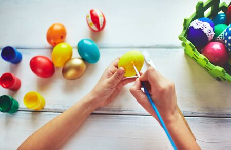 creative egg painting: Hands painting eggs Stock Photo