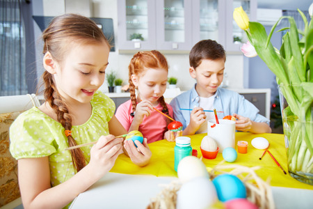 creative egg painting: Children painting eggs with gouache Stock Photo