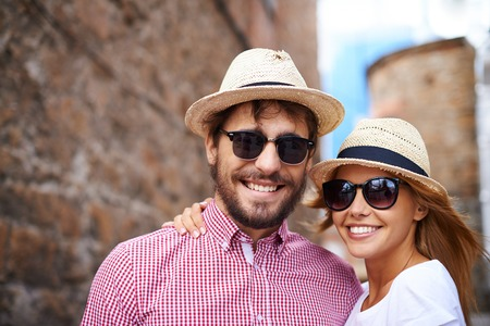amorous woman: Portrait of couple in hats and sunglasses