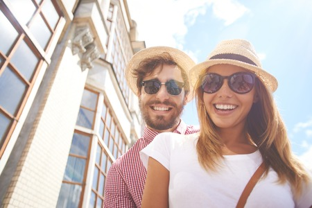 fashionable couple: Young couple posing in sunglasses