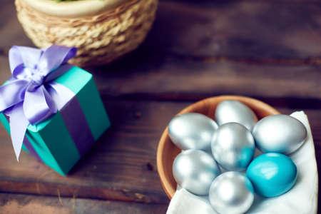 Silver eggs at a gift box photo