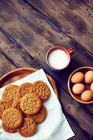 Gingersnaps with eggs and cup of milk photo