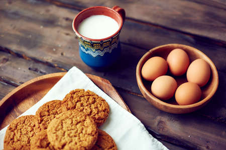 Close-up of cookies with eggs and cup of milk photo