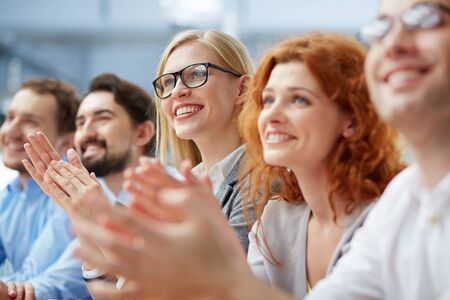 success focus: Row of business people sitting at seminar Stock Photo