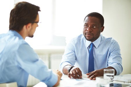 Serious manager talking to a candidate