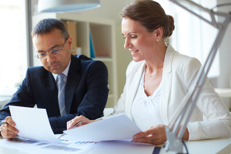 sharing: Two businesspeople sharing information Stock Photo
