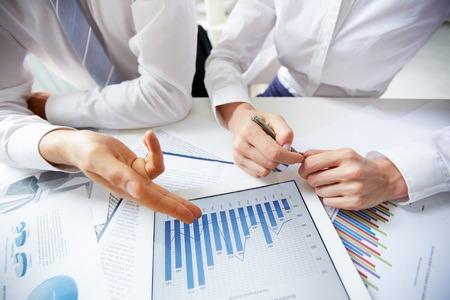 Businesspeople analyzing statistics photo
