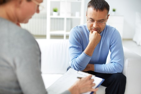 psychiatry: Man sharing problems with psychologist
