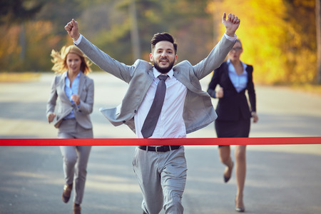 Businessman reaching finish line Stockfoto