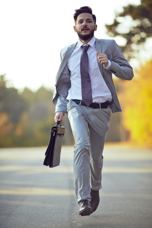 businessman running: Businessman running in park