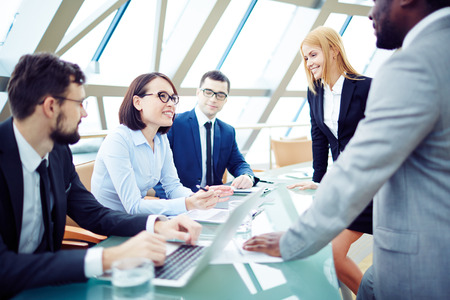 Business people communicating at meeting Stock Photo
