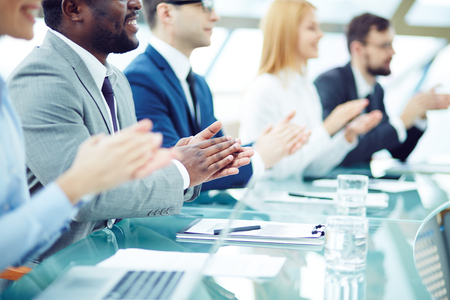 people clapping: Business people applauding at seminar Stock Photo