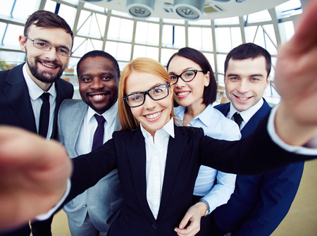 business executive: People taking selfie at business meeting