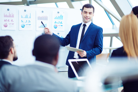 explaining: CEO explaining his plan Stock Photo
