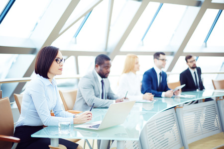 attentively: Business people sitting attentively at meeting