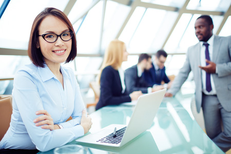 man with glasses: Young smiling woman at meeting Stock Photo