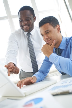 business consulting: Male colleagues discussing their cooperative work