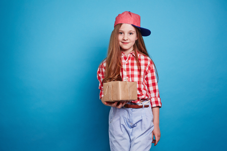 tied girl: Little girl holding a box, tied with ribbon Stock Photo