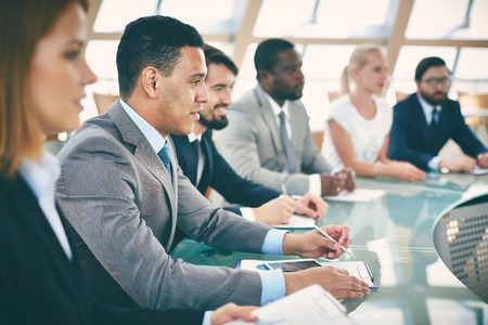 Business people sitting in conference hall Stock Photo