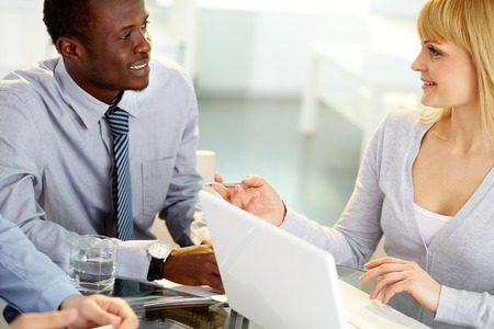 coworkers: Two co-workers exchanging ideas Stock Photo