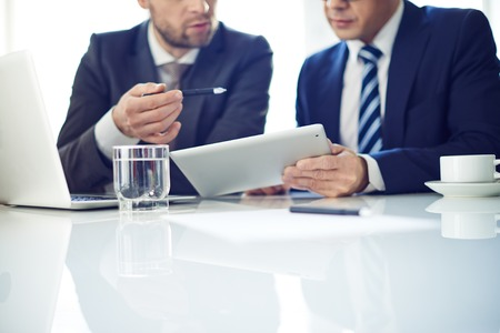 businessman: Two businessmen with tablet discussing project Stock Photo