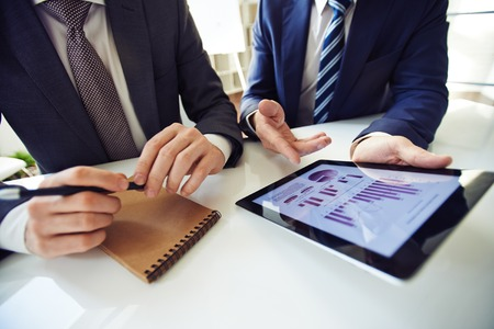 dolgozó: Businessmen discussing working moments. Stock fotó