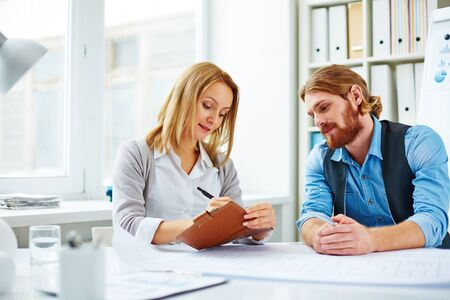 assigning: Woman assigning tasks for man