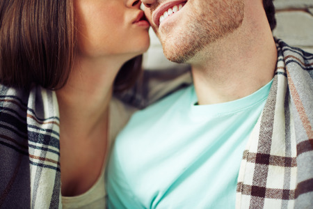 stubble: Woman kissing her man Stock Photo