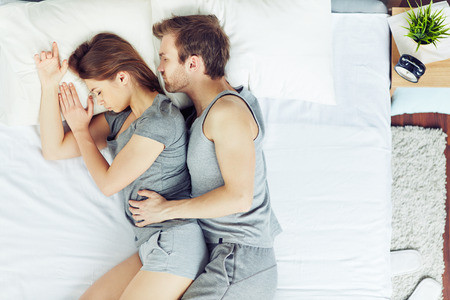 romance bed: Young couple sleeping in bed Stock Photo