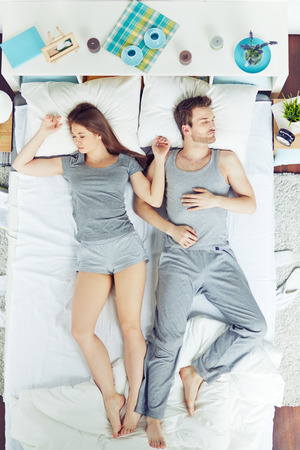 romance bed: High angle view of people sleeping in bed Stock Photo
