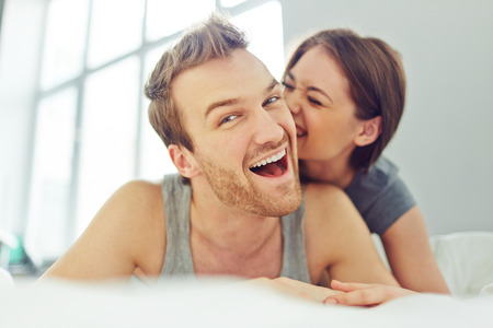 flirting: Woman flirting with her man in bed