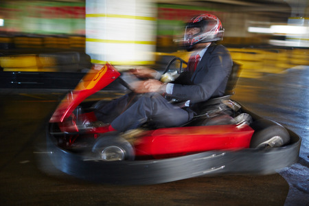 Brave businessman racing in go-kart