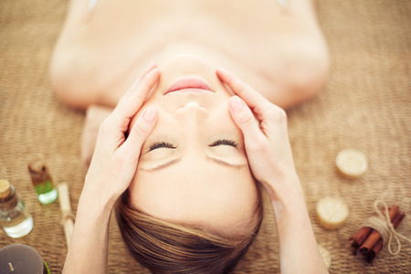 pampering: Therapist pampering female head