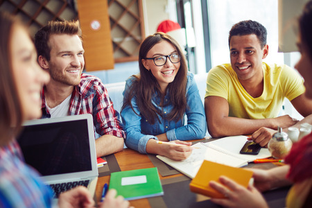 smiling people: Group of people talking to each other Stock Photo