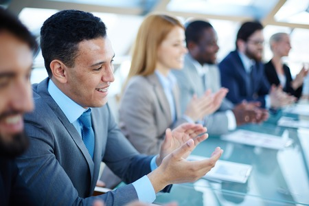 ovation: Happy business people applauding to speaker at seminar Stock Photo