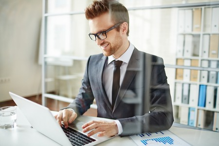 work addicted: Happy businessman networking in office Stock Photo