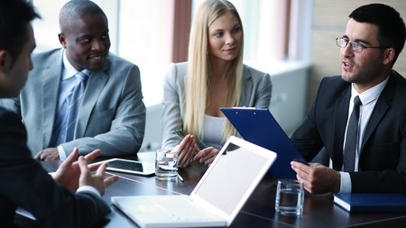 project: Elegant businessman presenting project to managers at meeting