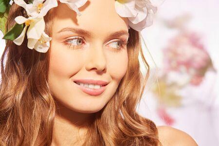 Beautiful girl with natural makeup enjoying sunshine Stock Photo
