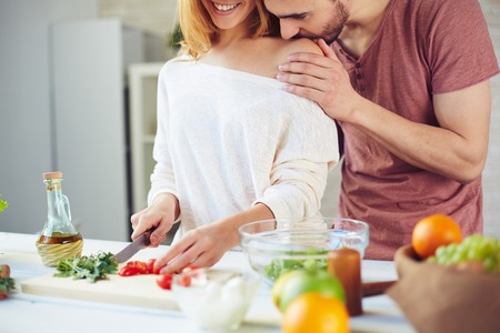 vegetables young couple: Young couple cooking salad for breakfast