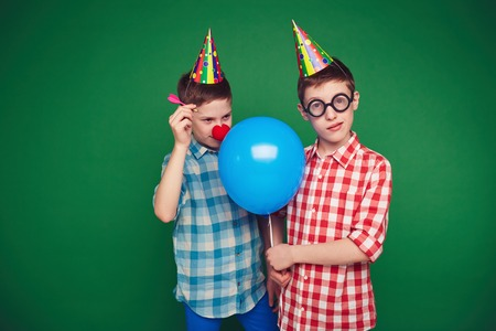 goofy: Goofy child going to burst balloon of his brother