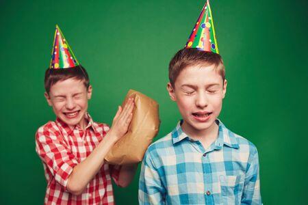 making fun: Twin boys making fun on April fool�s day