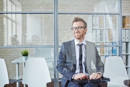 Successful young businessman sitting in office Stock Photo