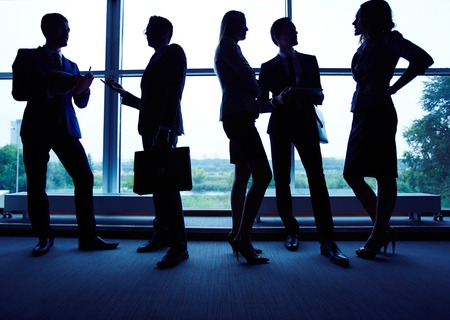 employee: Group of employees having business meeting against window
