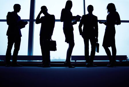 Several business partners having meeting by office window photo
