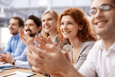 applauding: Group of business partners applauding at conference Stock Photo