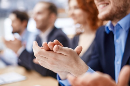 applause: Male hands applauding after presentation of project at conference