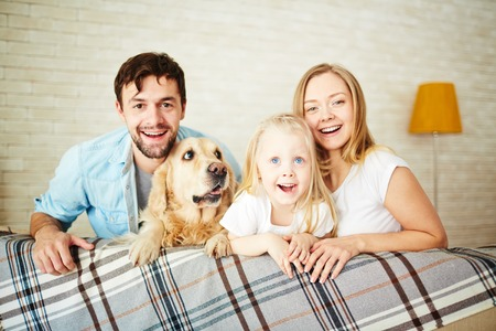 staying: Parents, their daughter and dog staying at home